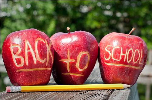 apples with back to school carved in them