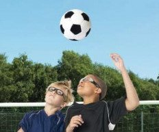 kids playing soccer with eyewear